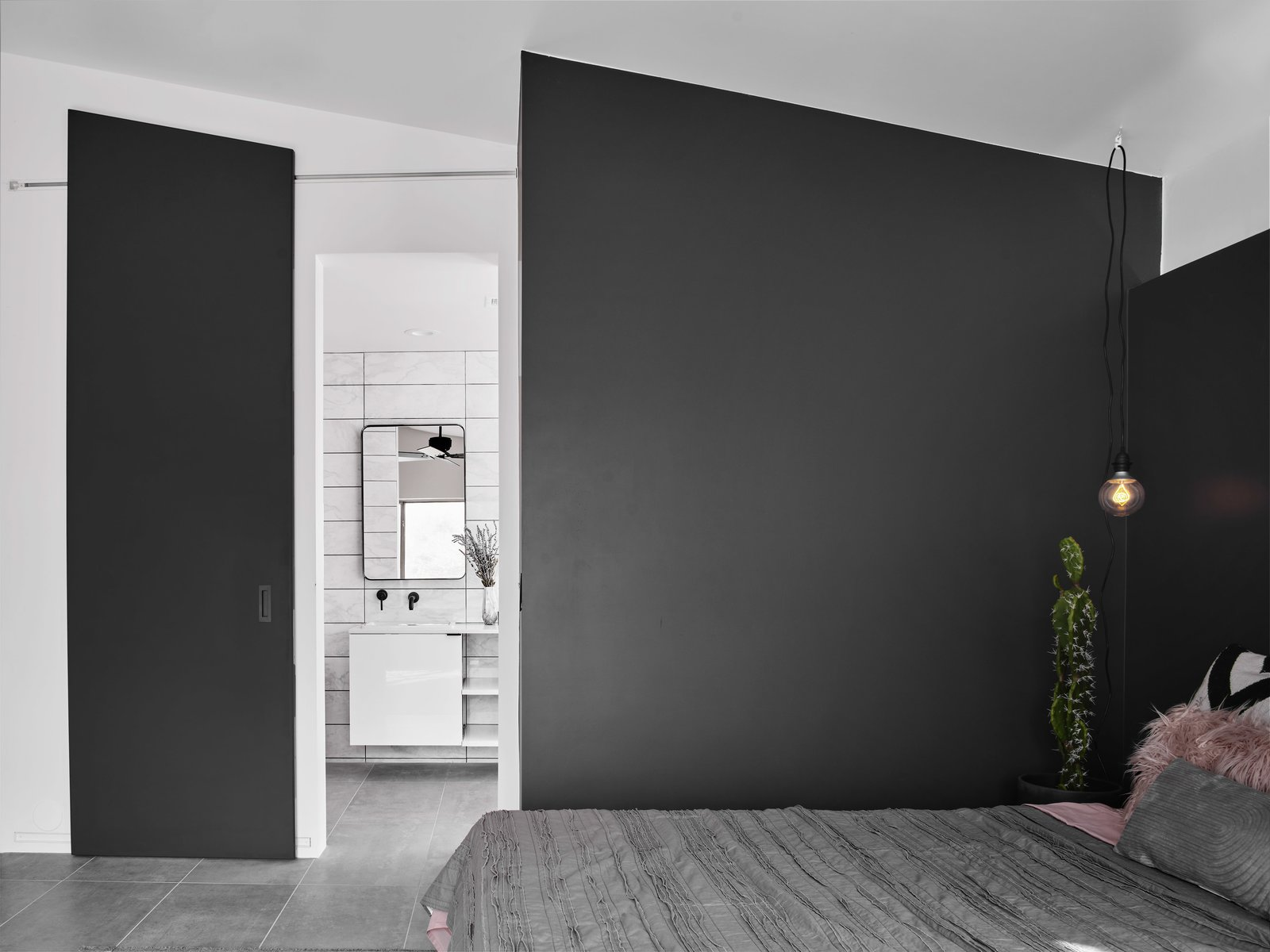 Doors, Sliding Door Type, Wood, and Interior The custom sliding bathroom door by Dotzler Design was made to disappear into the black wrap-around headboard of the bed.  Details