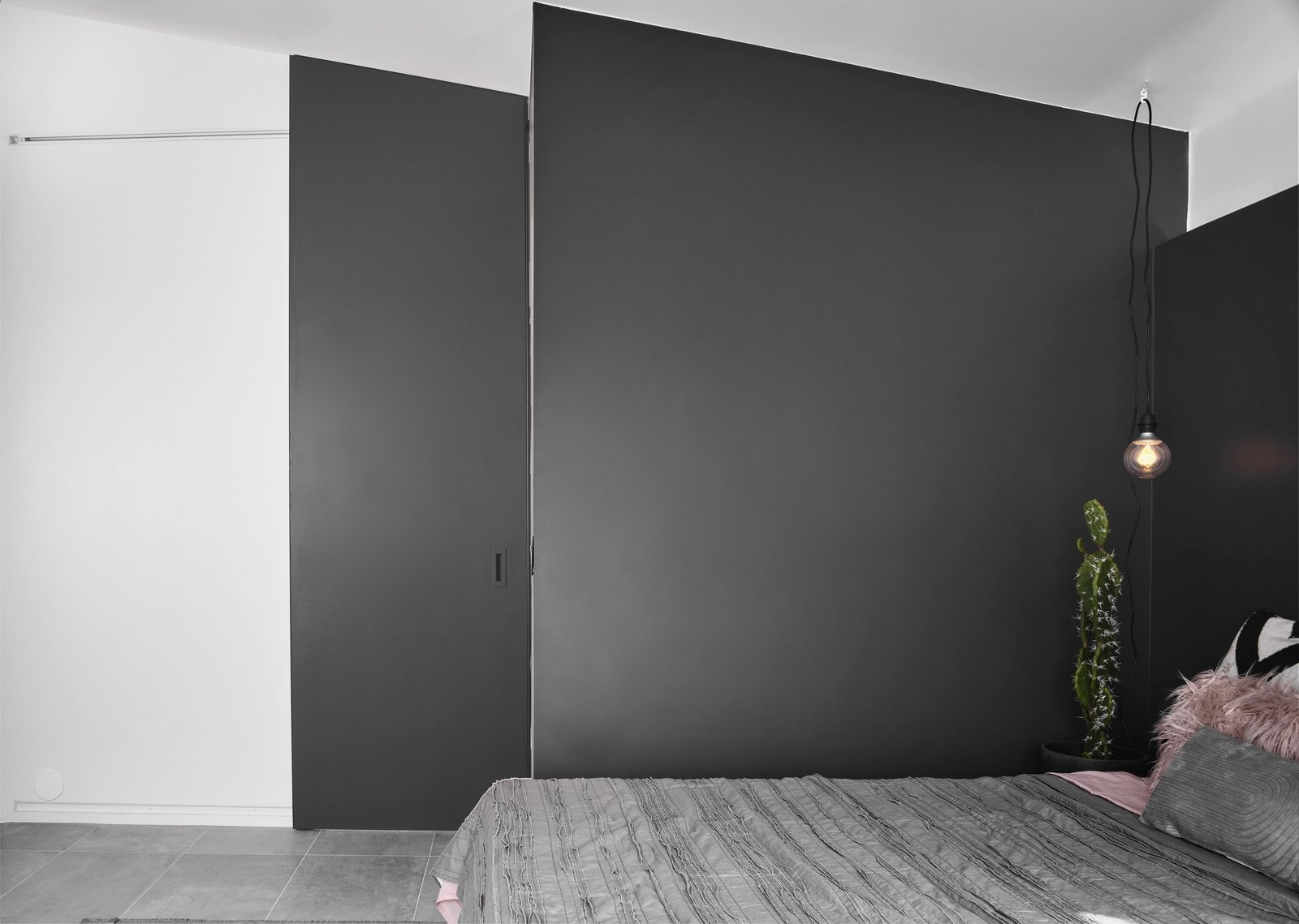Doors, Interior, Wood, Metal, and Sliding Door Type The custom sliding bathroom door by Dotzler Design was made to disappear into the black wrap-around headboard of the bed.  Details