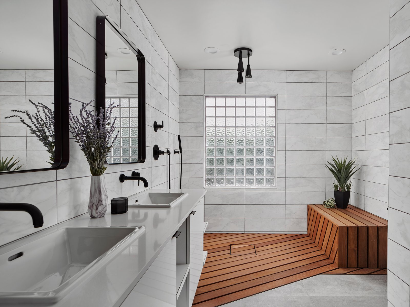 Bath Room, Engineered Quartz Counter, Open Shower, Porcelain Tile Floor, Porcelain Tile Wall, and Drop In Sink The master shower features an Ipe shower floor/bench and the vanity has cabinetry by Lignum Cabinets with custom open shelving that extends into the shower.  Details