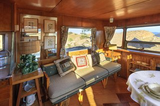 """Inside """"Gypsy"""" the Spartan Trailer observation lounge is a custom settee and dining area."""