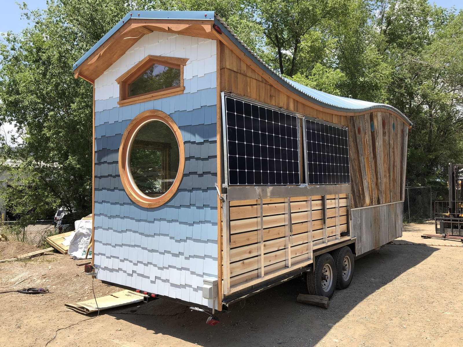 Exterior, Wood, Tiny Home, Metal, Metal, and Curved Exterior with porch folded in  Best Exterior Metal Wood Curved Photos from The San Juan Tiny House