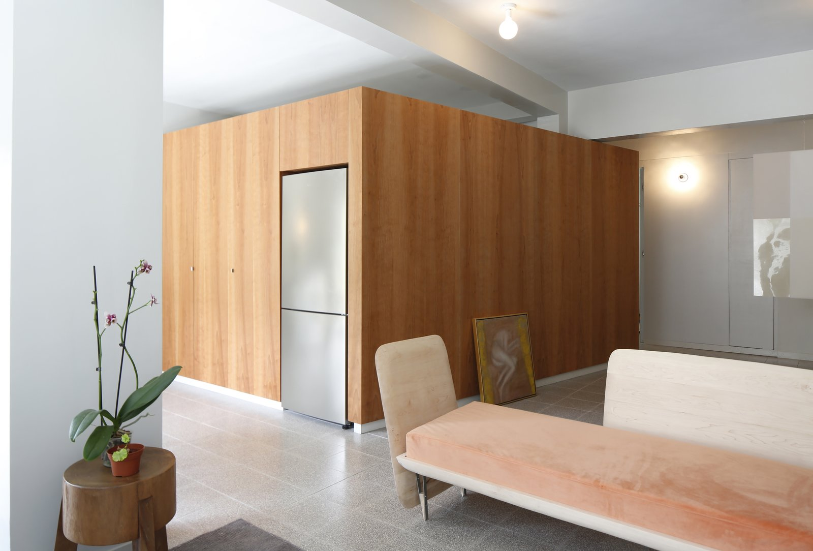 Living Room, Bench, Concrete Floor, Sofa, Ceiling Lighting, and Wall Lighting Living Room, Sofa designed by the Architects  Nahmani Tel Aviv Apartment