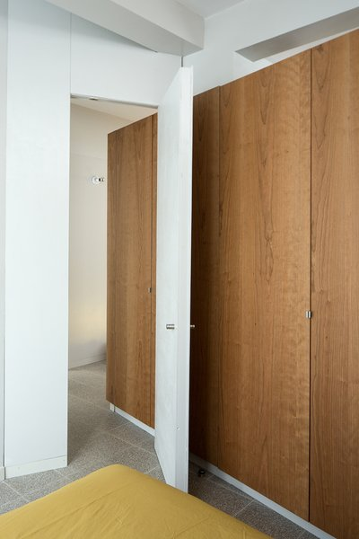 Bedroom entry with a custom door designed by the architects.
