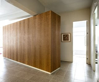 Cherry wood millwork unit as a multi purpose storage space