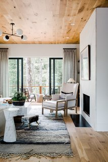 White walls allow for the natural light to really illuminate the space while soft colors prevent the space from looking one-dimensional.