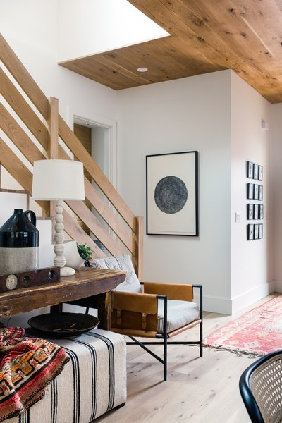 The entryway serves as the most welcoming spot in the home, with a multitude of textures lending a homely feel.