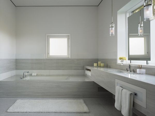 The master bathroom is a calming oasis of marble. The couple often relax here for a moment of tranquility.