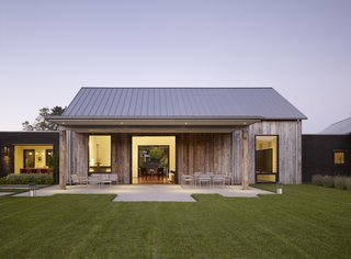The 5,200-square-foot retreat is designed to look like a cluster of old barns upon first glance.