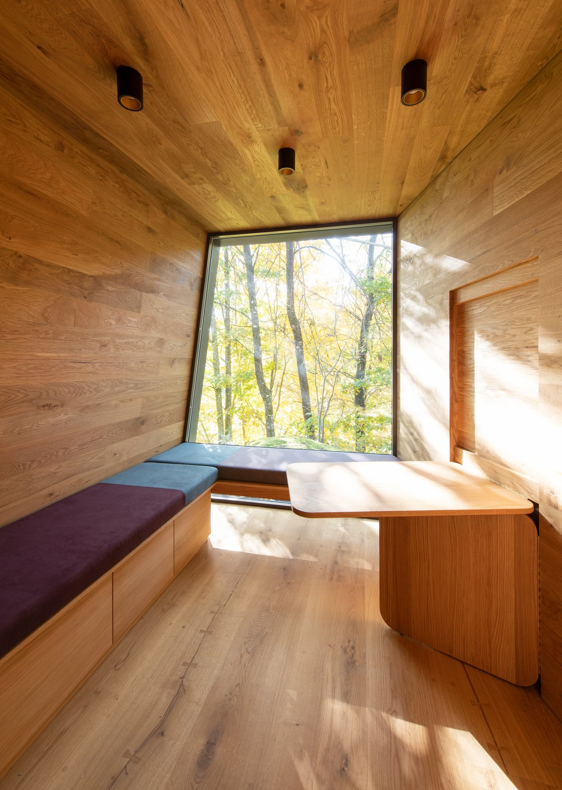 Shed & Studio and Storage Space Room Type Inside, playful pillows can be rearranged in any manner, and are often used as mock beds for relaxing and looking at the canopies above.  Photos from Snøhetta's New Cabins in Oslo Offer Refuge For Long-Term Hospital Patients