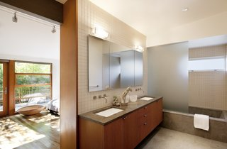 Modern tile in the bathroom and a minimalist bedroom give the home a polished, yet inviting, look.