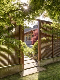The walls guarding the entryway provide privacy, but allow views and light to bleed through.