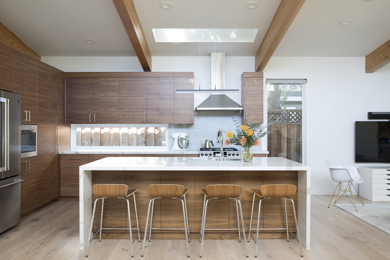 Kitchen, Microwave, Light Hardwood, Wood, Accent, Recessed, Range Hood, Refrigerator, Range, Marble, and Undermount Open plan kitchen with large waterfall island  Kitchen Microwave Accent Photos from Hedge