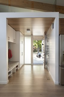 Built in storage keeps the entryway clear of clutter.