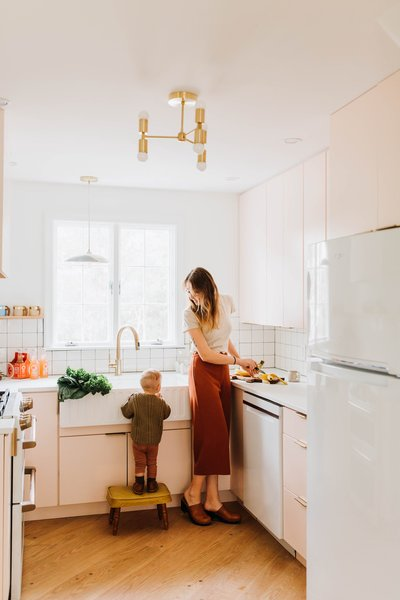 The renovated kitchen of Louise Avenue features a deep sink and a coat of pastel-pink paint. Homeowners Chris and Claudia Beiler lovingly restored the home after purchasing it in 2018.