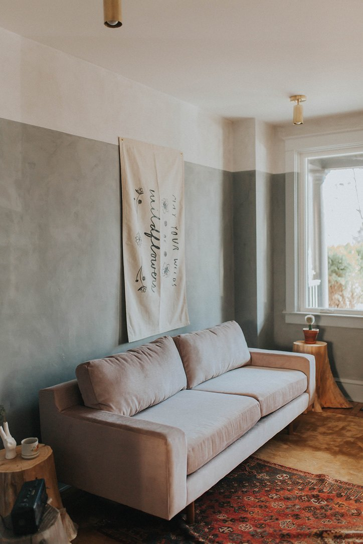 Living Room, Accent Lighting, Sofa, and Light Hardwood Floor In the living room, we added fun two-toned lime wash walls!   Drab Lancaster City Row Home gets a Pear-colored facelift by The Chris & Claude Co