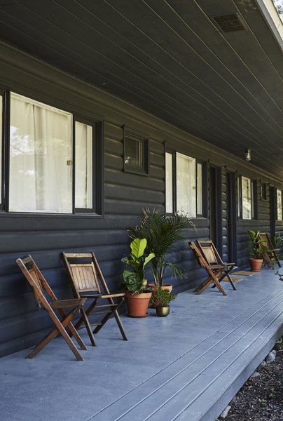 The lodge used to have a reddish-brown exterior. Pflug modernized the hotel with a blue-black paint from Farrow & Ball.