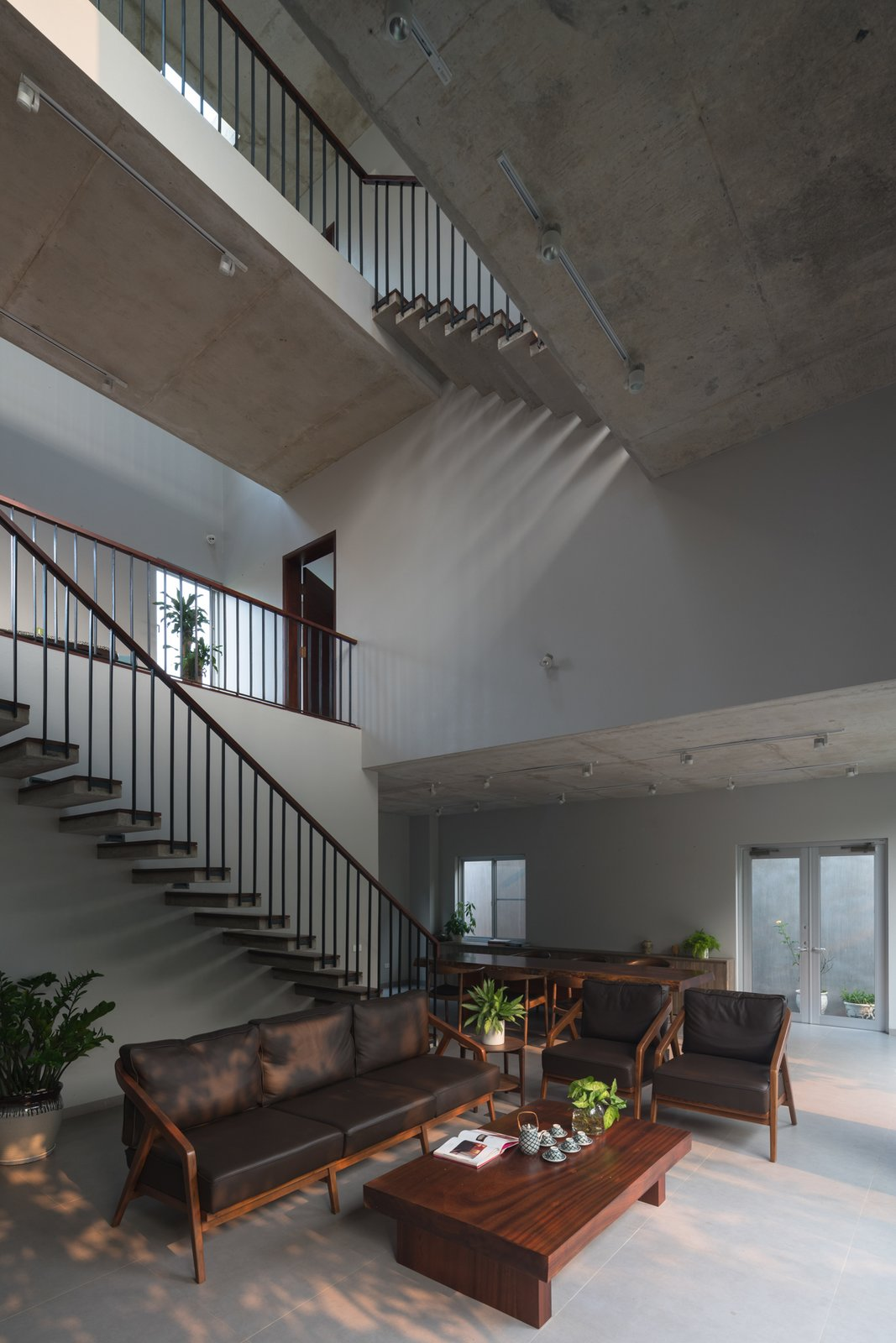 Living Room, Ceramic Tile Floor, Ceiling Lighting, and Sofa The whole house is a brick and concrete three-storey block, with a large central space in the middle of which is a common area for family activities such as living room, reading room, exercise room, etc...  Ninh Binh House
