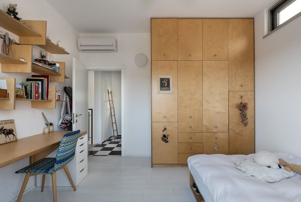 Neuman Hayner designed The House by the Dunes for a family of five who all enjoy surfing the beaches of Israel. The architects took a minimalist approach to designing each room, keeping colors and materials simple yet functional.