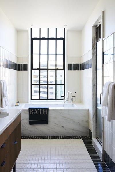 Bathrooms incorporate custom glazed tile and Imperial Danby stone quarried in Vermont.