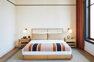 A cheerful striped blanket is among the custom Shinola features in guestrooms.