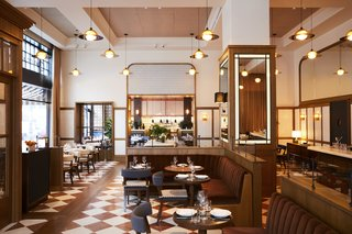 In the restaurant San Morello, a palette of soft brown, white, and blue is amplified by soaring window panels.