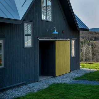 Incorporating a 12-inch-thick double stud exterior wall, the contemporary farmhouse is a prime example of green construction, down to the air-to-water heat pump boiler.