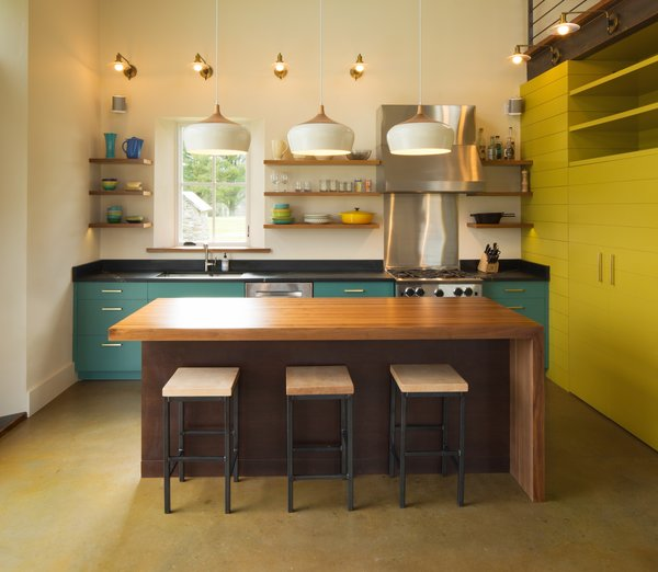 The Smith family desired an open kitchen, reinforced by shelving and minimal amounts of locally made cabinetry.