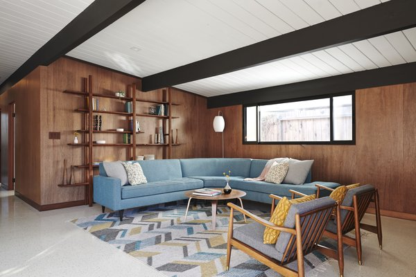 """Every mahogany wall was replaced with new ones, the contractor """"painstakingly going through literally hundreds of panels over several days to find ones that matched,"""" recalls Blaine. Since the quarter inch-round mahogany corners at the outside of the interior walls found in Eichler homes are no longer made, Blaine worked with the contractor to find a supplier of rounds that were then cut down to quarters."""