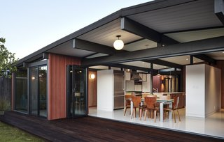 In the South Bay, San Jose–based BLAINE Architects expanded this Eichler by transforming the old carport into an atrium. A folding glass NanaWall system allows the owners to watch their kids in the playroom from the kitchen.