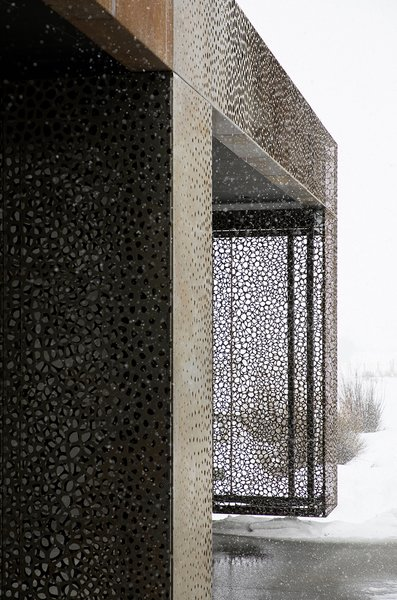 The intricate metal curtain doubles as a work of art.