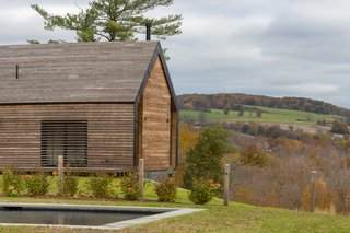 Creeks and pastures dot the home's tranquil Hudson Valley surroundings.