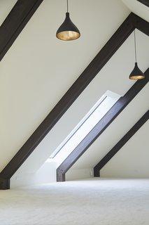 Natural light pours through the timber-framed loft.