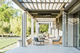 Teak furniture, sourced from Teak Warehouse, adds a fitting lightness to the patio.
