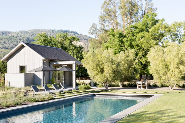 The pool house patio, featuring Harbour Outdoor sun loungers.