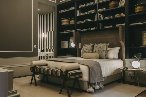 """The """"Suleiman"""" room, on the ground floor, nods to African-inspired design through touches like the traditional woven baskets peppering the expansive bookshelves."""