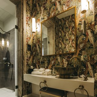 "Bold, whimsical wallpaper covers the ""Exotic Birds"" bathroom."