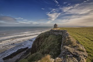 Downhill Strand in County Londonderry, Northern Ireland. Mussenden Temple is perched on cliffs above the beach.