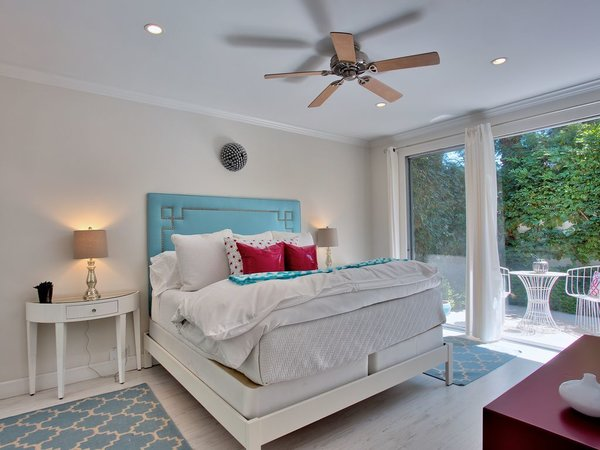 One of the bedrooms, featuring a whimsical mix of blue and fuchsia.