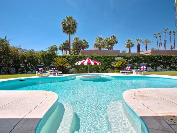 The curvaceous pool, reminiscent of the Hollywood Golden Age, is the stand-out feature of the backyard.