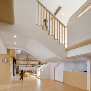 The staircase is a defining feature at the school, connecting the flexible play area with the science and art classrooms.