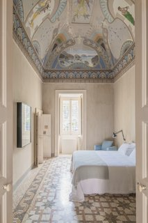 A ceiling fresco and mosaic floor steal the limelight in the Royal Junior suite.