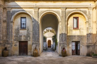 Palazzo Daniele's stunning courtyard. In the distance is the circular-domed Kaffeehaus, a one-time aristocratic hangout where guests can now savor candle-lit dinners.