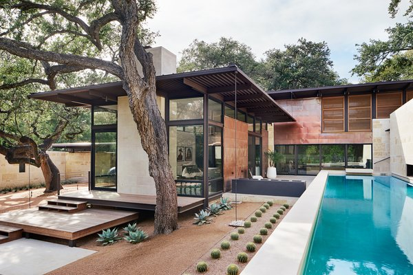 The home's abundance of glass creates a peaceful dialogue between the indoors and outdoors.