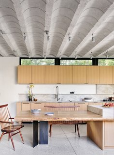 In the kitchen, the concrete, barrel-vaulted ceiling adds an industrial air.