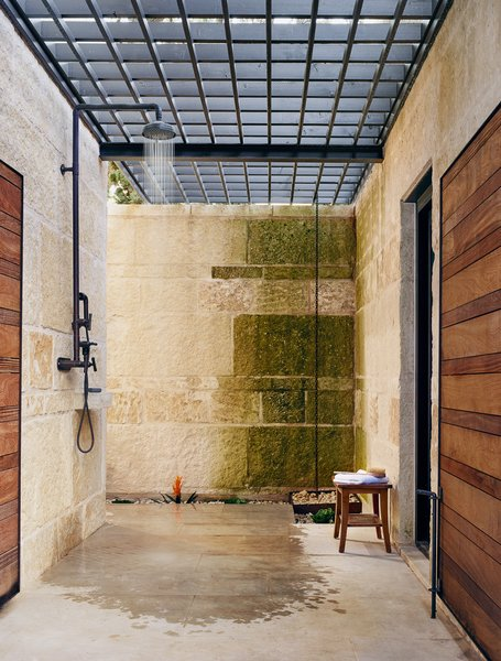 An alfresco shower encourages guests to linger outdoors.