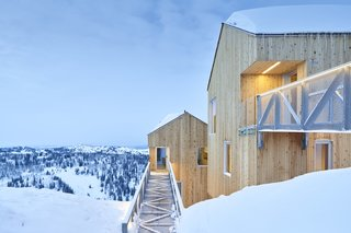Cabins are accessed via steel bridges on the second floor, a clever way of responding to the extreme annual snowfall amounts.