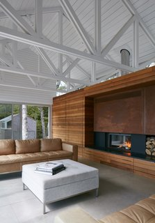 A fireplace wrapped in cedar comes to the rescue on chilly summer nights.