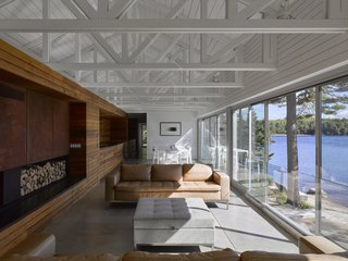 The stunning 80-foot-long glass wall opens up to the outdoors and brings the lake inside.
