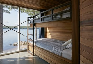 Bunk beds, cleverly built into the cedar millwork, face the lake.