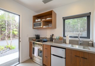A craftsman from Washington State  made the cabinetry for the well-equipped kitchen.